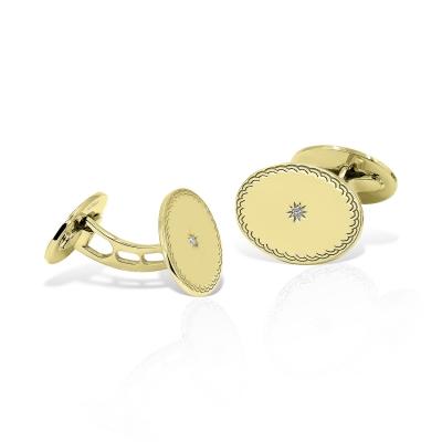 Butoni ovali din aur cu diamante