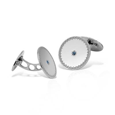 Butoni rotunzi din aur cu diamante albastre